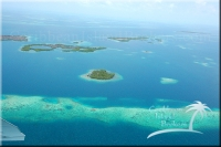 This is looking east beyond secret island. Little Cat Caye is about a half mile to the east with the souther portion of Big Cat Caye in the upper left corner of the picture